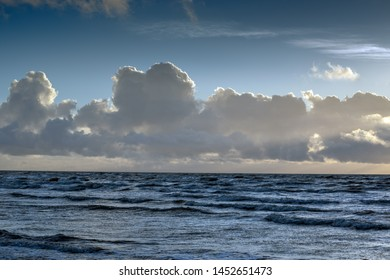 Clouds above Baltic sea in sunset time.