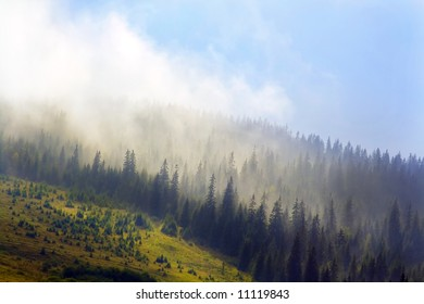 clouds above mountainous landscape, fog over the mountain in the morning