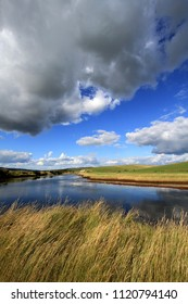 Clouds above the river at Cuckmere Haven, Sussex, UK