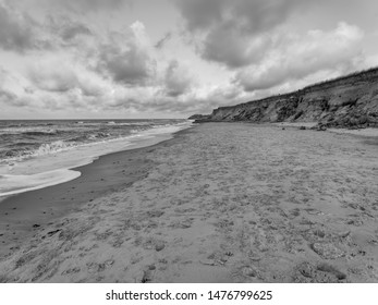 Clouds begin to fill the darkening evening sky over a deserted Happisburgh beach in the county of Norfolk