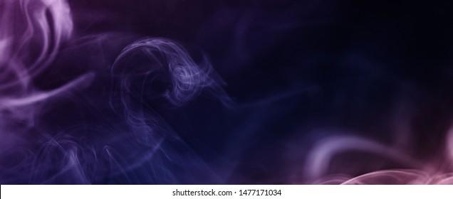 Clouds of blue cigarette smoke