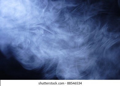 Clouds of blue cigarette smoke second hand smoke from a cigarette