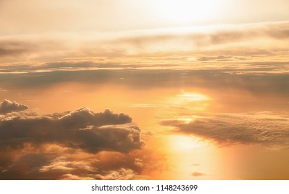 Clouds up in the blue, blue sky. Celestial colours of yellow and golden brown with the free wind