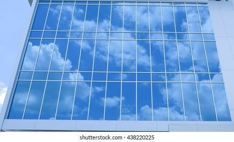 clouds blue sky reflection in the glass window