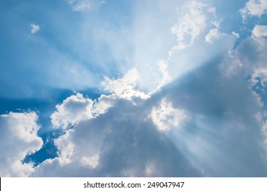 clouds in blue sky with sun-rays