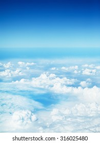 clouds in a blue sky, view from airplane