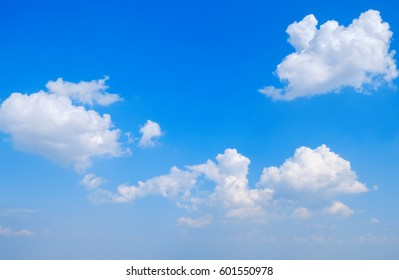 Clouds and bright blue sky background