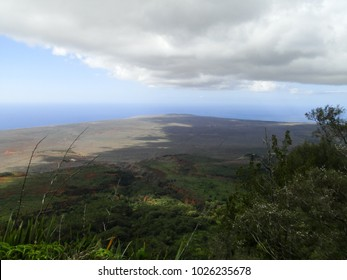 Clouds cast shadows over the landscape of Lanai.
