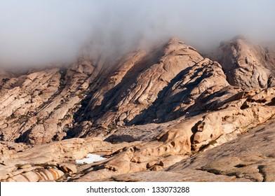Clouds in desert mountains Bektau-Ata in Kazakhstan
