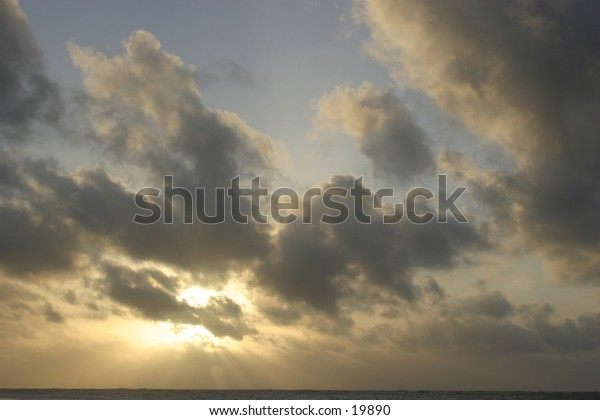 Clouds in the early morning sky above the ocean