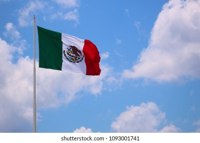 Clouds and Mexico´s flag