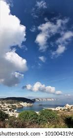Clouds follow island