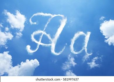 A clouds font calligraphy style ,hand written on sky background.
