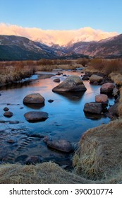 Clouds form over the continental divide in Rocky Mountain National Park as the Big Thompson River starts flowing in the spring run off