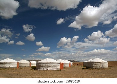 Clouds and gher in gobi desert in mongolia