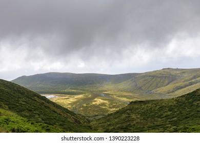 Clouds hang low over Caldeira Branca in the Reserva Florestal Natural do Morro Alto e Pico da Se, Flores.