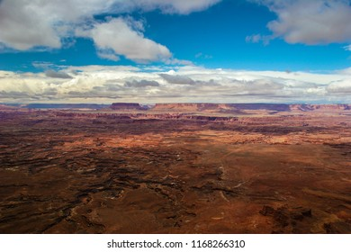 Alot of the clouds have lifted to reveal many more beautiful land formations and the maze of canyons at the Needles Overlook near Monticello, Utah.