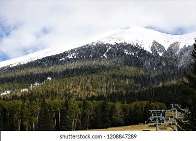 Clouds hovering over snow covered mountain in Flagstaff Arizona
