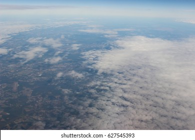 Clouds and land viewed from above