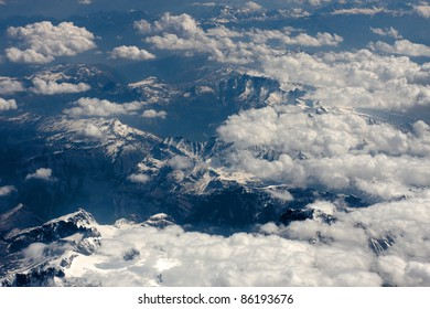 Clouds and mountains taken from above from an air craft