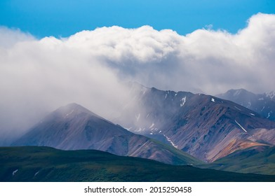 Clouds move up and down the Alaska Range Mountains