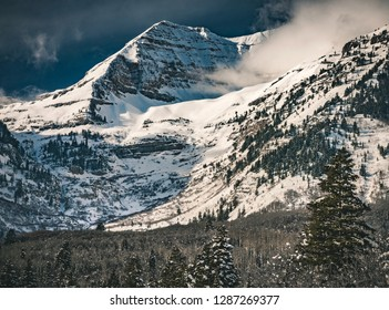 Clouds move over the dramatic snow capped peaks of Mount Timpanogos after a winter snowstorm clears the Wasatch Mountain Range near Sundance in Provo Canyon, Utah, USA.