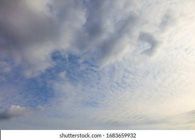 Clouds on a blue sky as a background. Texture