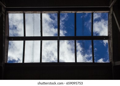 Clouds on the blue sky, through the lattice on the ceiling