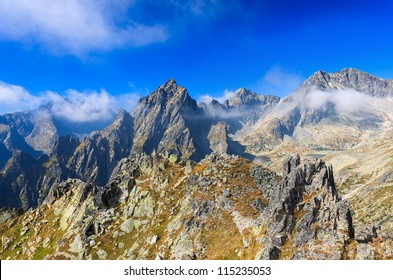 Clouds on blue sky with view of High Tatra Mountains, Slovakia