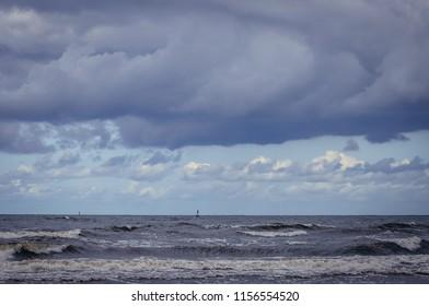 Clouds over Baltic Sea beach in Swinoujscie, Poland