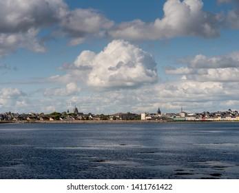 Clouds over Galway city Ireland, Atlantic ocean, Claddagh area, Galway Cathedral dome.