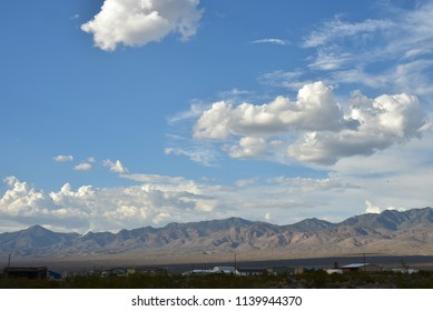 clouds over hills and mountain range in the Mojave Desert town of Pahrump, Nevada, USA