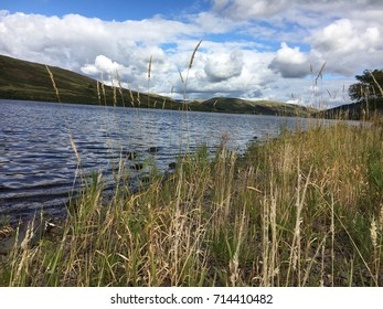 Clouds over lake, St Mary's Loch, Scotland, Great Britain
