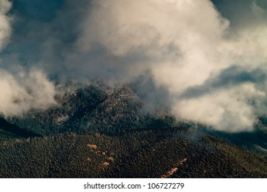 Clouds over a snow capped alpine mountain in the victorian high country, australia.