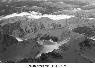 Clouds over snowcapped mountain range, Sun Peaks Resort, Sun Peaks, British Columbia, Canada