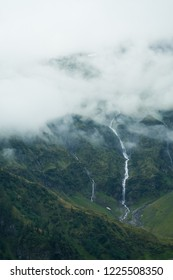 Clouds over the watterfall in Austrian Alps
