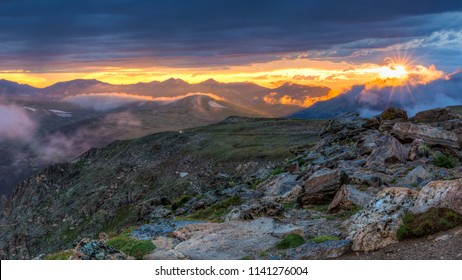 The clouds parted for an instant behind the Never Summer Mountains at Sunset on Trail Ridge Road in Rocky Mountain National Park, Colorado.