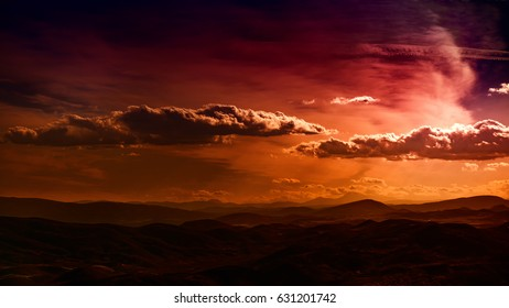clouds passing by in a sunset sky