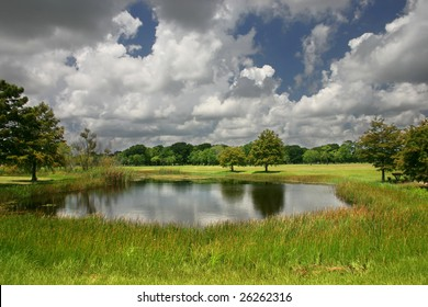 clouds passing over a pond