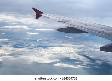 Clouds and planes from high angle of travel.