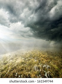 Clouds and rain in the autumn field