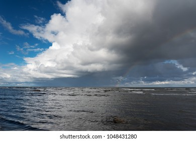 Clouds and rainbow over gulf of Riga, Baltic sea.