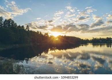 clouds reflected in the lake at sunset
