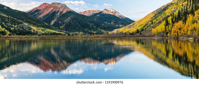 Clouds reflected in rippled Crystal Lake below the Red Mountains in Autumn in the Uncompahgre National Forest south of Ouray, Colorado. (panorama)