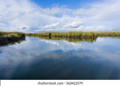 Clouds reflected in the salt ponds of Don Edwards Wildlife Refuge, south San Francisco bay, Alviso, San Jose, California