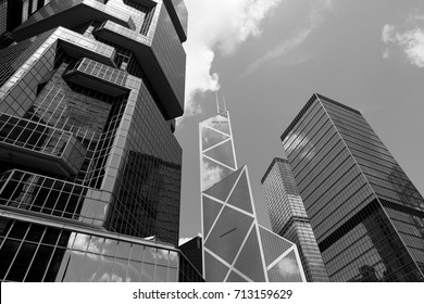 Clouds reflected in windows of modern office building (Black and White)