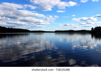Clouds reflecting on Sharbot Lake