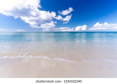 Clouds reflecting over the turquoise blue sea on a sunny and warm day in the Turks and Caicos Islands