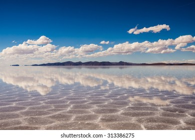 clouds reflecting in the uyuni salt lake in bolivia