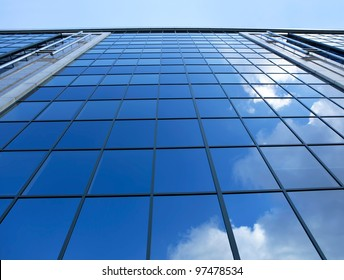 A clouds reflection in glass wall of business building